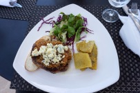 A delicious steak at Tempus Alba, topped with caramelized onions and blue cheese crumbles.